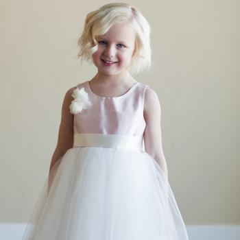 blush pink and tulle flower girl dress with flower motif in pink, blue, green and other colours