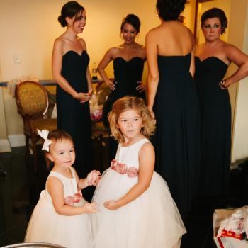 Toddler flower girl dresses in ivory with peach flowers and a tulle skirt.
