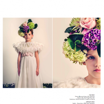 A flower girl wearing an ivory, cotton flower girl dress with a tulle skirt and a hat with purple, green, white and pink hydrangea flowers.