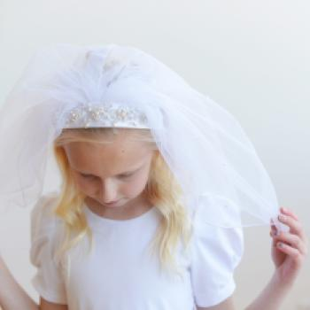 A traditional first communion veil with a beaded headband and a double veil.