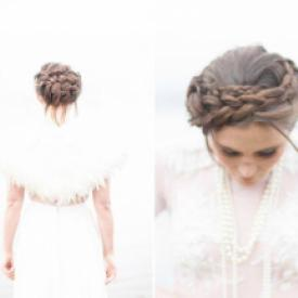 A bride wearing a wedding shawl with layers of ivory feathers and ribbon trim.