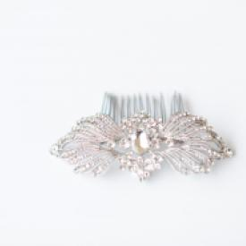 A silver deco Gatsby style hair comb with diamante leaf pattern.