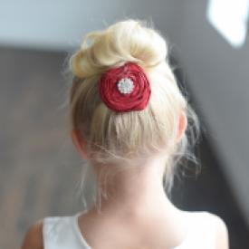 Red rose flower girl hair clip with a diamante centre on a barrette hair clip